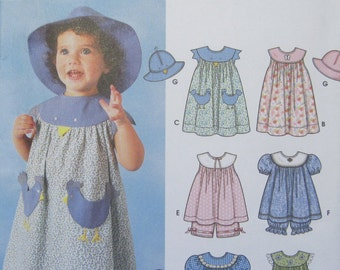 Simplicity 7189 -- Babies and Toddlers Dress, Top, Panties and Hat pattern. Sizes 1/2, 1, 2, 3, 4. Pattern is uncut and factory folded.