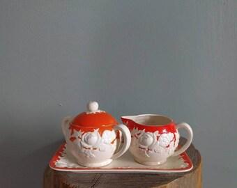 vintage floral sugar and creamer set in orange and white