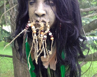 Shrunken head v2 (long hair w/green feathers)