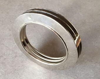 round tin bracelet nickelled