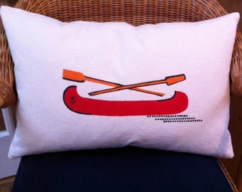 red canoe with paddles pillow