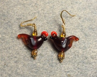 Translucent dark amber red crested lampwork songbird beads adorned with amber Czech glass beads.
