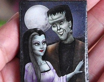 The Munsters pin. Wooden brooch with Lily and Herman Munster illustration. Own illustration based on the classic TV show characters