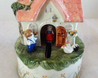 1983 Schmid Cottage Music Box Moving Girl Plays Tomorrow. Signed on Side. pLays Beautiful.