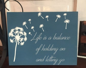 Life is a balance of holding on and letting go custom hand painted wooden sign