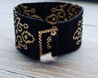 Beautiful black peyote miyuki delica cuff bracelet with topaz pattern