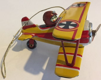 Vintage tin Christmas ornament airplane and pilot made in Germany