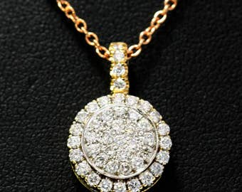 Diamond drop pendant set in 18k two-tone with 68-round diamonds at 1.00ct total weight
