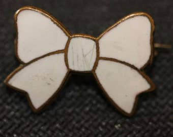 Antique signed Wolews white enamel bow pin