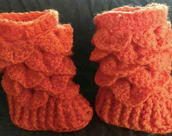 Orange newborn crocodile stitch bootees