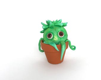 Succulent plant creature with big eyes figurine clay sculpture in tiny clay pot