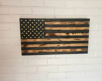 Burnt American Flag with 9mm casings