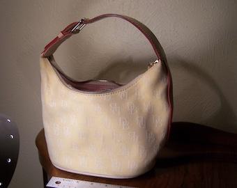 Vintage Dooney and Burke light yellow canvas handbag.
