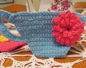Blue Crocheted Tea Cup Coaster with Pink Flower