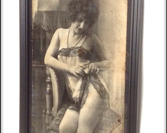 Aged reproduction vintage erotica lady in camisole - framed.