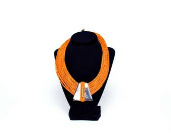 Tribal Collection, Golden leather necklace adorned with polished horn and brass