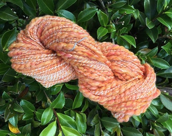 Hand spun art yarn, chuncky spiral yarn, merino, silk, orange, white