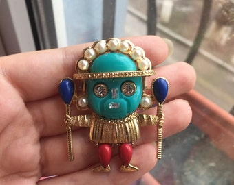 Kenneth Jay lane (KJL) medicine man brooch/pendant made of plastic artificial stone-jade, coral, turquoise