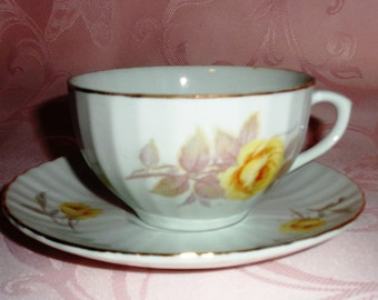 Vintage Nippon Yoko Boeki Co. Porcelain Scallop Textured Teacup and Saucer Set with Yellow Roses and Gold Trim