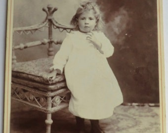 Cabinet Card Photo Little Girl Finger on Chin Ghost Like Background