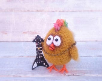 Chick rocker with an electric guitar, handmade crocheted toy, amigurumi
