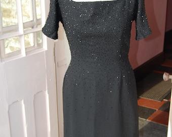 Vintage 1950s  tailored wool crepe beaded little black dress