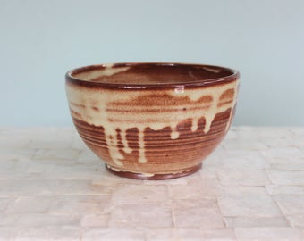 """Rust and cream small serving bowl 