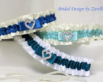 Wedding garter/Bridal garters. White/Ivory satin with green contrast trims & silver coloured heart. 'Something blue' added.