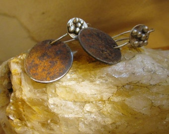 Rusty steel disc and sterling wire earrings.