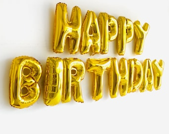"""Happy Birthday Balloons. Happy birthday sign in gold letter balloons. 16"""" (16 inches) Gold foil / mylar letters for a birthday party banner."""