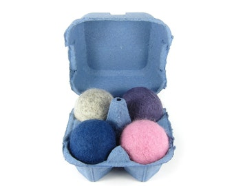 Felted wool cat toy ball collection in blue, pink,  grey and purple with blue egg carton for storage