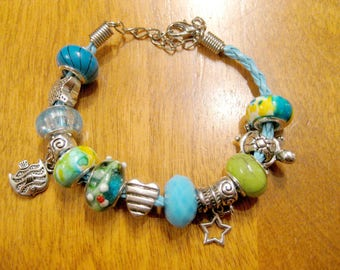 Blue and green with charms and charms fish and turtle bracelet