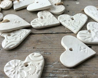 Handmade Ceramic hanging white hearts ornaments. Perfect for Christmas, gift tags, birthday, wedding favours, made with white clay