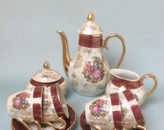 RESERVED FOR H  Vintage demitasse lusterware tea set with image of Fragonard courting couple