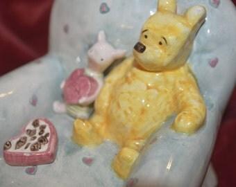 c. A Walt Disney Winnie the Pooh money box, Charpente classic pooh money box,  valentines chair money box, Winnie the pooh 1980s