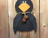 Handcrafted and handpainted crow wall hanging.