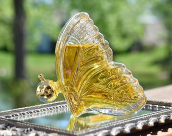 Avon butterfly bottle iridescent glass with topaz cologne. 1.5 oz vintage Avon butterfly perfume bottle.
