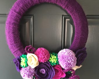 Rainbow yarn wreath with felt flowers