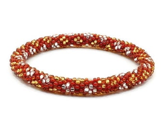 Roll on beaded friendship bracelet.  Red bracelet with gold and silver dots. Hippie Bracelets.