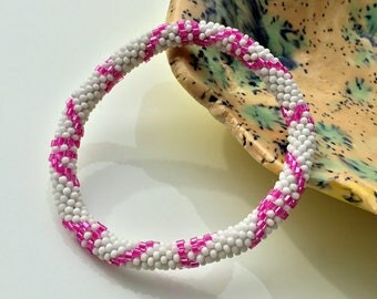 White with Pink Beads Nepal roll on Bracelet. Glass seed bead roll on bracelet.