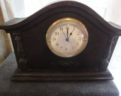 Art Deco case clock in wood powered by battery white dial with brass surround