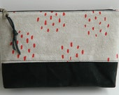 scren printed pencil zipper pouch, printed fabric, black waxed canvas contrasting bottom, red dots, flax linen, leather pull, make up bag