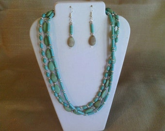 190 Intriquing Three Strand Magnesite Turquoise Beaded Necklace with Silver Colored Bead Accents