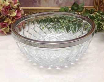 Rimmed pressed glass bowl.