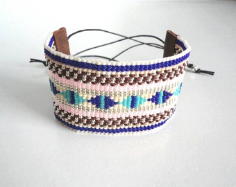 SALE!!! Hand-woven beaded Bracelet by miyuki beads nr 11. Finished with faux suede and candle rope.