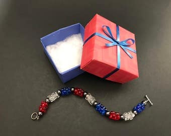 A red, white and blue beaded bracelet in a gift box