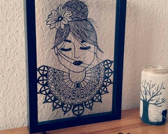 The dreaming girl. Paper cut. Is hand drawn and hand cut