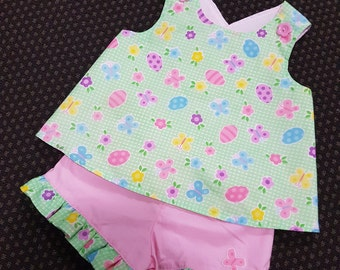 A cool summer pinafore and shorts size 6 to 12 mths