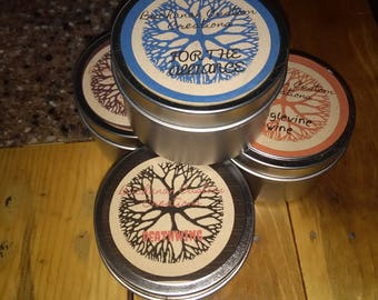 4-pack 6 ounce themed tin candles