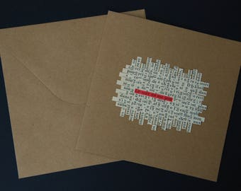 """Card mailing collage of text lines woven paper - crossword - """"the spell is cast"""""""